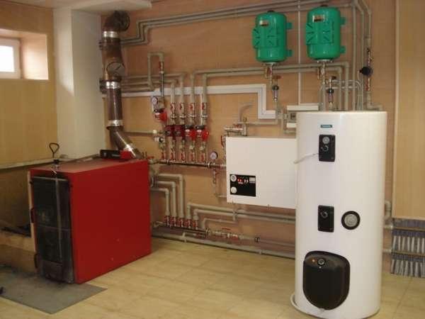 Газово-твердотопливная система отопления