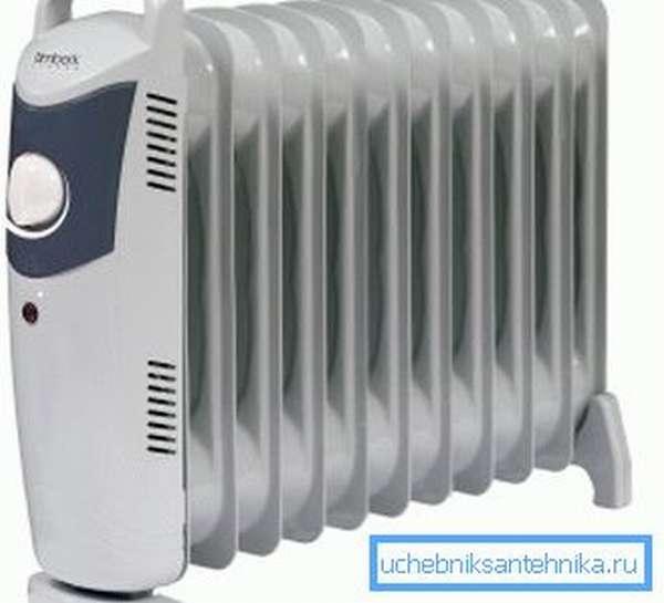 Маленький масляный радиатор – отличное решение для дополнительного обогрева