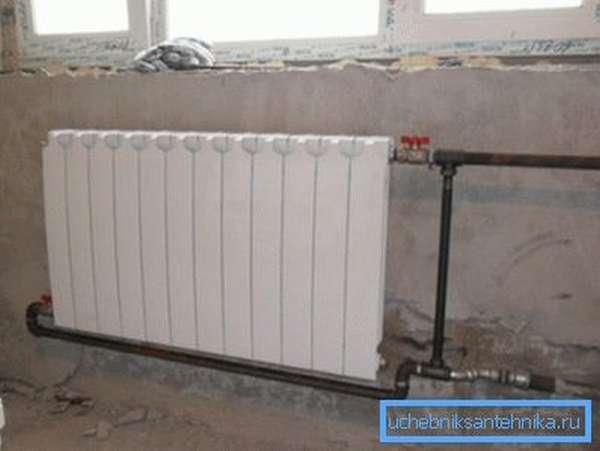 На фото – диагональный способ подключения радиатора из 12 секций