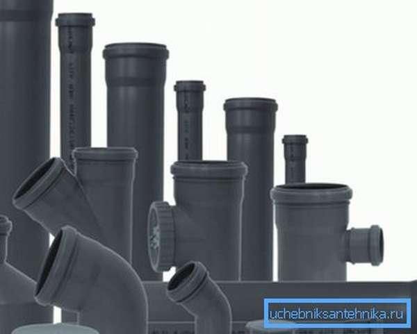 На фото - конструкционные элементы для строительства полимерной внутренней канализации
