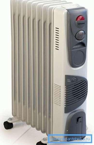 На фото - масляный переносной радиатор