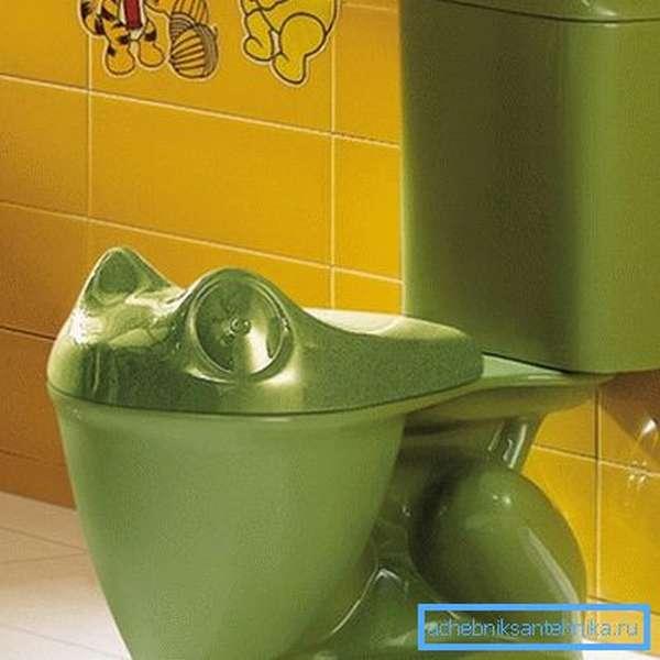 На фото - сантехнический прибор в виде лягушки