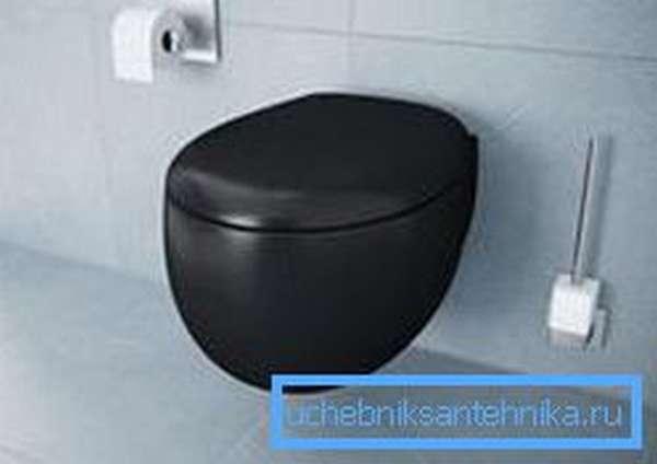 Округлые формы чёрного унитаза в стиле модерн