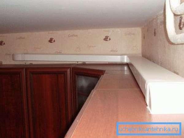 Спрятать конструкцию на шкафу.