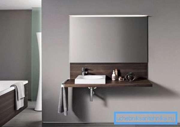 Стильная консоль под раковину в ванную занимает минимум места.