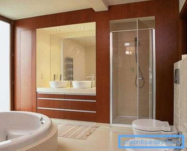 Стильный и функциональный интерьер ванной комнаты с душевой кабиной