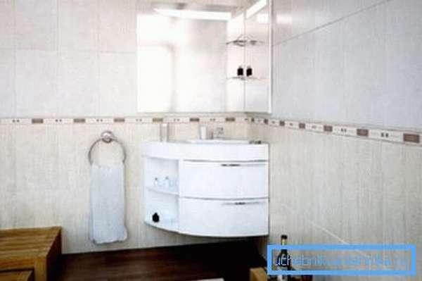 Угловой умывальник в интерьере современной ванной комнаты
