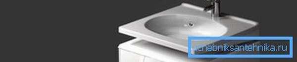 Умывальник, разработанный для установки над стиральной машиной